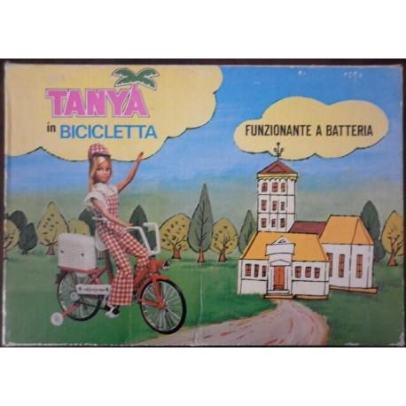 Bambola Tanya in bicicletta